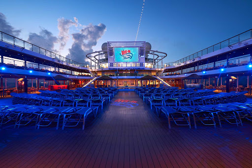 carnival-Panorama-Pool-Deck-big-screen.jpg - Jump in or grab a comfortable lounge and a snack for evening viewings of popular movies on Carnival Panorama.