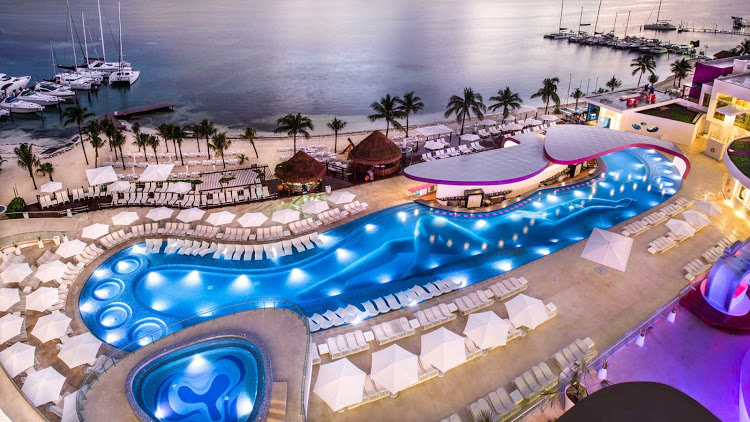 A look at the Sexy Pool at dusk from the Tower at Temptation Cancun Resort.