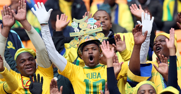 Mamelodi sundowns fans celebrate during the match against Barcelona. Picture: MASI LOSI