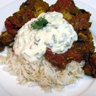 Pakistani Chicken In A Tomato and Eggplant Stew With Yogurt Cucumber Sauce.