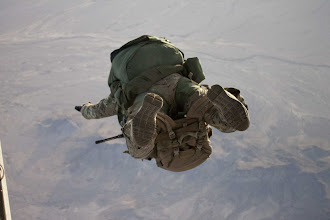 Photo: A special-operations Soldier attending the Advanced Tactical Infiltration Course at the Military Freefall School exits an aircraft to conduct a high-altitude, high-opening airborne operation with a full combat load March 10 in Yuma, Ariz.