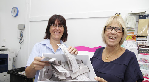 The Courier's Sue Newton and Wanda Dunnet with some of the 375 entries from potential tipsters in the 2018 NRL tipping competition. The 24 tipsters were drawn from the barrel and the successful entrants notified.