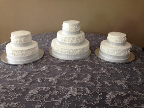 Photo: 3-tier wedding cake w/two sides cakes (2-tiers).