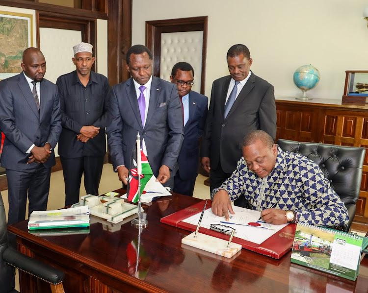 President Uhuru Kenyatta when he signed into law the Land Value (Amendment) Bill, 2019 at State House Nairobi on August 2, 2019.