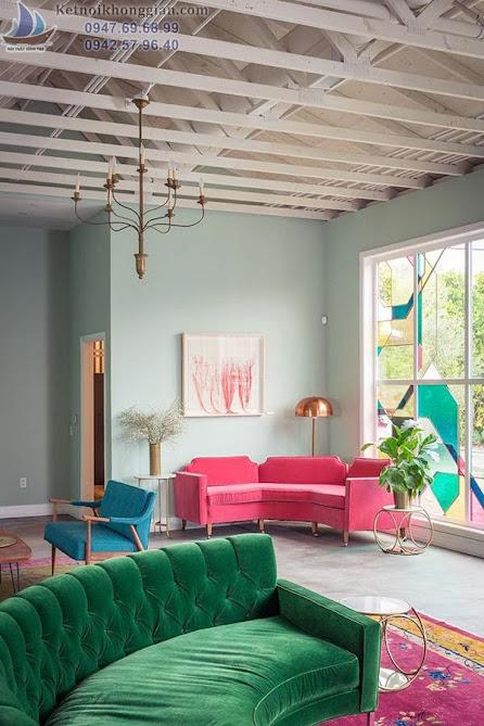thiết kế phòng khách với màu hồng áp đảo