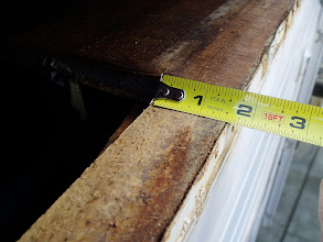 Photo: Top of wall.  The wood was inside the roof panel that fell apart when lifted off.