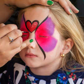 Face painter at work by Joe Saladino - Babies & Children Children Candids ( face painting, girl, face painter, child )