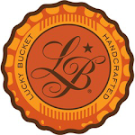 Logo of Lucky Bucket Whiskey Barrel Aged Certified Evil