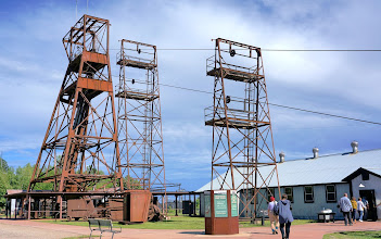 Photo: Headframe and visitor center at Soudan Underground Mine State Park. The cables which raise and lower the elevator lead from the engine house which contains the hoist.