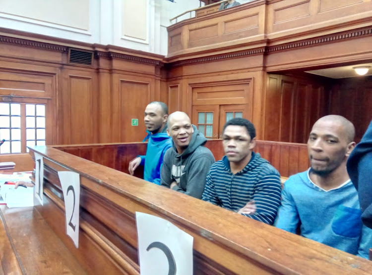 The men accused of raping and murdering Hannah Cornelius put hands over their gaping mouths as the meaning of their tattoos was described in the high court in Cape Town.