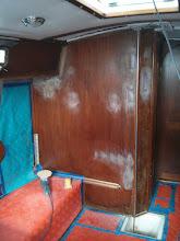 Photo: sanding down filler and new tabbing on port salon bulkhead