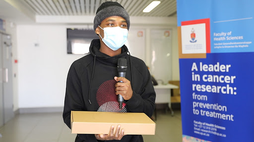 A University of Pretoria student receives his tablet device.