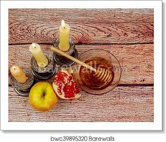 a color image of beeswax candles and honey
