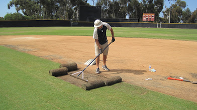 Photo: Still going back and fixing areas that need to be raised or lowered before the sod roots.