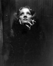 Photo: Chiaroscuro lighting was prominent in Von Sternberg's films (like SHANGHAI EXPRESS, for which this is a publicity still).  This borders between a 'production still' and a glamour portrait: a production still is an artificial reconstruction of a moment from the film, often taken on the set of the film, but not an actual piece of 35mm film from the film.  (8x10 glossy portraits of this type were generally shot using a camera that captured an 8x10 negative, so the prints could be made directly from the negative, which was typically heavily retouched.)