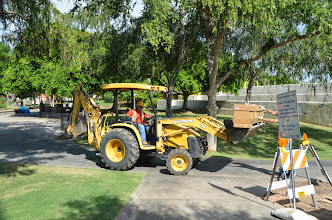Photo: Brian of Team Fishel driving the back hoe that nearly crushed him two years ago.