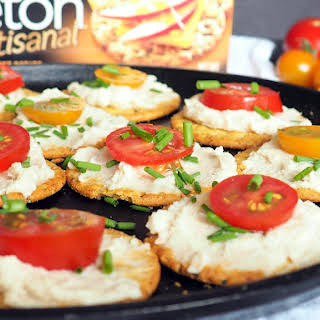 White Bean Dip with Tomatoes and Chives on Crackers.