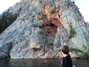 Photo: Cole is telling me about jumping off the rock.