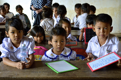 Children in a classroom in Vietnam were eager to practice their English with foreign visitors.