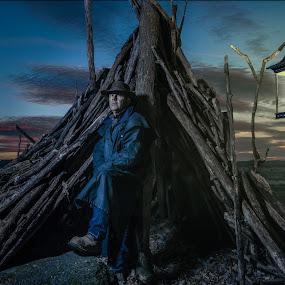 rest stop by Eric Bureau - People Portraits of Men ( lantern, cowboy, sunset, riding jacket, light, man )