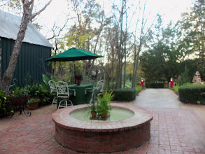 Photo: Tour of Homes 2012: Byrd House - bricked patio/yard with fountains