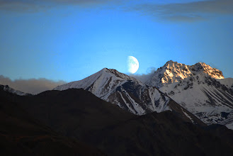 Photo: The moon peeking over mountains in Denali National Park. By Keira Burrows