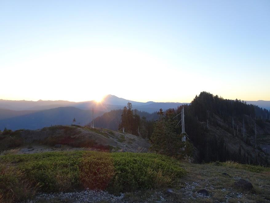 Sun rises behind Mt Adams