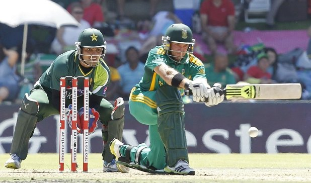 Pakistan wicketkeeper Kamran Akmal, left, watches South Africa's Colin Ingram in Bloemfontein. Picture: REUTERS