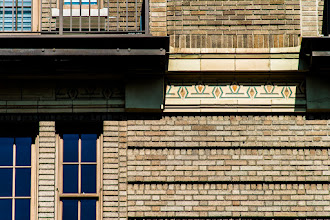 Photo: This is another shot that I took during a mid-morning walk along Central Park West in New York City. I don't remember exactly where I was, but I liked the brick pattern and the decorative elements of this building.