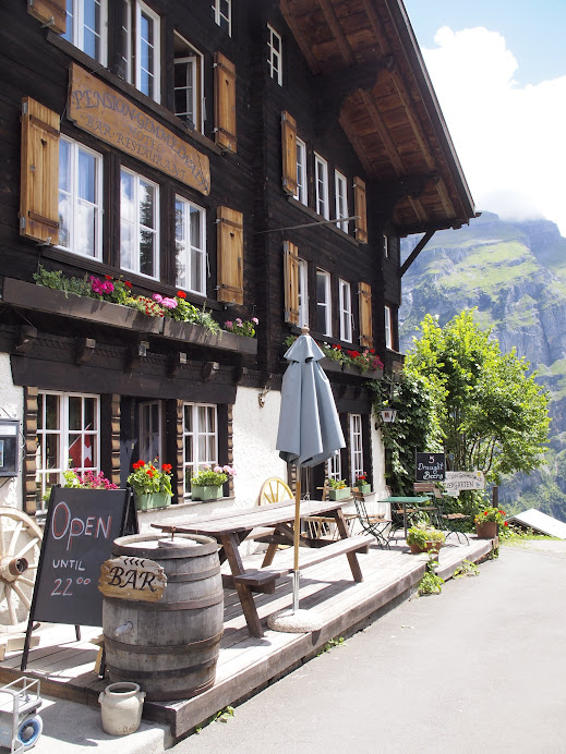 I love these mountain chalets with wooden shutters - they're all over Lauterbrunnen area