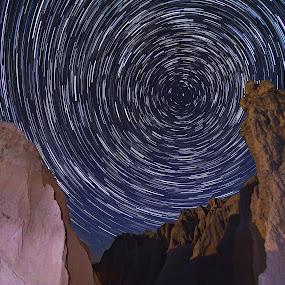 Badlands Spin by Evan Ludes - Landscapes Starscapes ( dakota, stars, trail, star, south, north, polaris, trails, astronomy, badlands )