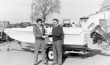 "Photo: Club Secretary, Bryan Ryan accepts delivery of the new ""Piranha"" Club Boat from Peter Lawless in Caherdavin."