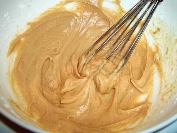 In a small bowl, whisk all glaze ingredients until creamy. Add more sugar or...