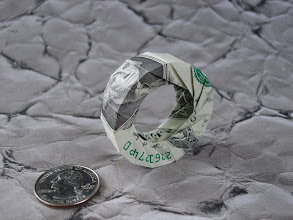 Photo: Model: Dollars To Doughnuts;  Creator: Philip Chapman-Bell;  Folder: William Sattler;  1 dollar;  Source: The Fitful Flog http://origami.oschene.com/archives/2005/03/19/dollars-to-doughnuts/
