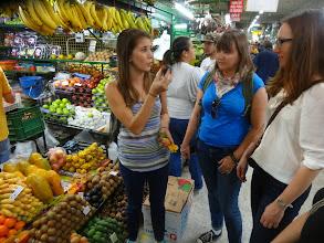 Photo: Marcela leading a fruit tour at the Minorista market