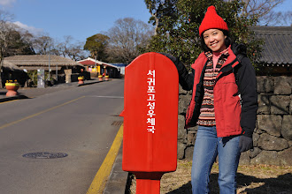 Photo: This is a postbox. I have no idea what the Korean characters say but there seems to be a lot of characters. On the left is the main road through the village.