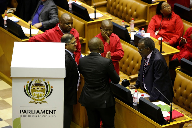 Opposition party leaders Mmusi Maimane (DA), Julius Malema (EFF) and Mangosuthu Buthelezi (IFP) confer shortly before voting during the motion of no confidence against President Jacob Zuma in Parliament, Cape Town, on Tuesday. Picture: REUTERS