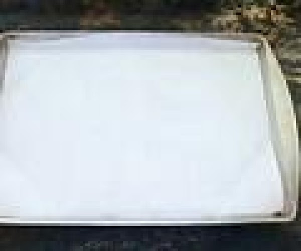 Line a cookie sheet with parchment paper , then sprinkle with a small amount...