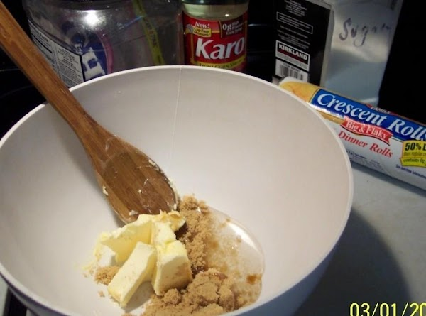 In a small bowl combine brown sugar,  softened butter and corn syrup. Spread and press...