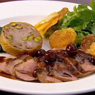 Grilled Duck Breast with a Confit Duck Neck Sausage.