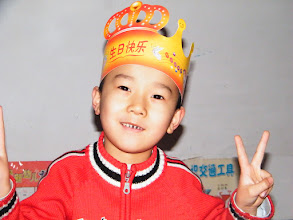 Photo: baby son, warrenzh, 朱楚甲 cheers for his cake.