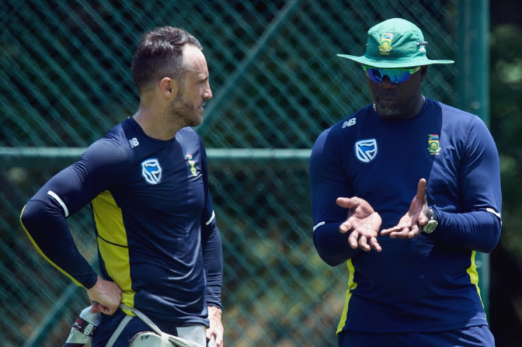 SA senior men's national cricket team captain Faf du Plessis (L) in a discussion with head coach Ottis Gibson (R) during a training session at Pallekele International Cricket Stadium on August 3, 2018 in Balagolla, Sri Lanka.