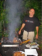Photo: Mark grilling skewered pork