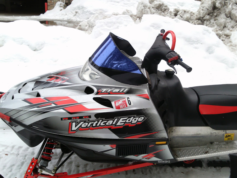 Photo: A snowmobile parked next to the trail.
