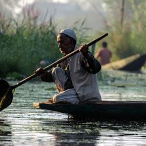 Morning Contemplations by Rohit Chawla - People Portraits of Men ( dal lake, himalaya, kashmiri, kashmir, cosurvivor, india, boat, portrait )