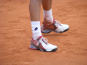 Photo: The famous Roland Garros red clay (la terre battue) takes its toll on players' apparel. The shoes may live for another day, but those socks will never be white again.