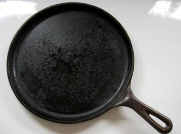 You should have your cast iron flat griddle heated I have a electric range...