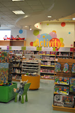 """Photo: We spotted the """"Activity"""" section and headed over to look for some activity books to keep my little people busy over the summer."""
