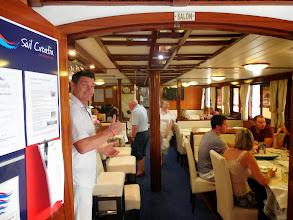 Photo: Host, waiter, bartender - Arnando - welcomes everyone to the Captain's dinner.
