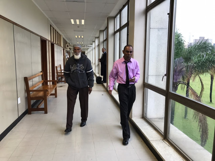 Mohammed Ebrahim, right, and his father Sheik Ebrahim Shah in the halls of the Durban magistrate's court.